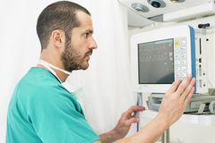 Medical doctor making ECG test in hospital. Medical Concept Royalty Free Stock Photos