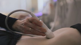 Medical doctor making ultrasound with modern equipment stock video