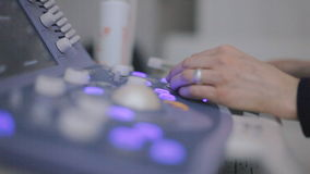 Medical doctor making ultrasound with modern equipment stock footage