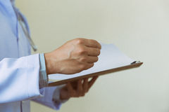 medical doctor man with clipboard. Medical care, insurance, pres Royalty Free Stock Photo