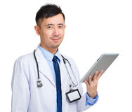 Medical doctor man hold tablet computer Royalty Free Stock Photo
