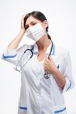 Medical doctor in mask having headache Royalty Free Stock Images