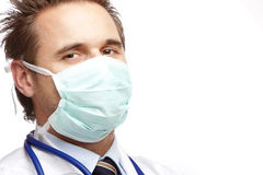 Medical doctor  with mask and stethoscope Stock Photos