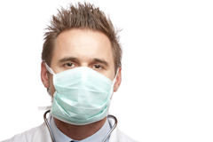 Medical doctor with mask and stethoscope Royalty Free Stock Photos