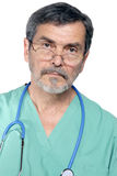 Medical Doctor MD Surgeon. Medical doctor with stethescope looking serious Stock Photos