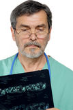 Medical Doctor MD Surgeon. Medical doctor looking at xray Royalty Free Stock Photo
