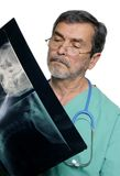 Medical Doctor MD Surgeon. Medical doctor looking at xray Stock Photo
