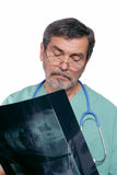 Medical Doctor MD Surgeon. Reading x-ray Royalty Free Stock Image