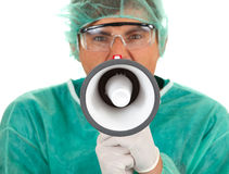 Medical doctor with megaphone Royalty Free Stock Images
