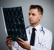 Medical doctor with MRI spinal scan Royalty Free Stock Photos