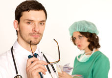 Medical doctor with nurse Royalty Free Stock Photo