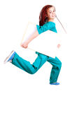Medical doctor or nurse jumping with whiteboard Royalty Free Stock Images