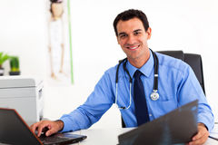 Medical doctor office. Handsome medical doctor working in office stock photography