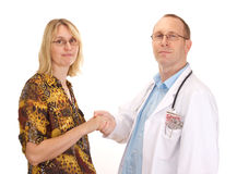 Medical doctor and patient handshaking Royalty Free Stock Photos