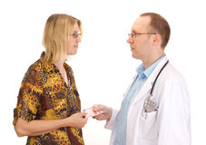 Medical doctor and patient with money Stock Image