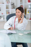 Medical doctor with phone Royalty Free Stock Images