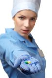 Medical doctor with pill Stock Images
