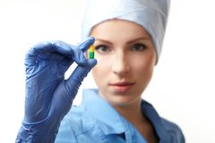 Medical doctor with pill Royalty Free Stock Photography