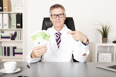 Medical Doctor Pointing Money on Other Hand Royalty Free Stock Images