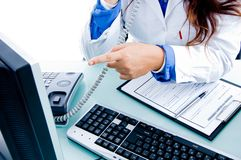 Medical doctor pointing at monitor Royalty Free Stock Photos