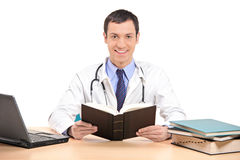 Medical doctor posing in his office Royalty Free Stock Images