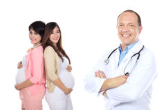 Medical doctor with pregnant woman Royalty Free Stock Images