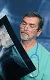 Medical Doctor reading X-ray. Medical Doctor with stethoscope reading X-ray Royalty Free Stock Photography
