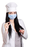 Medical doctor with red pills isolated Royalty Free Stock Photography