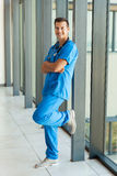 Medical doctor relaxing. Smiling medical doctor relaxing in hospital hallway stock images
