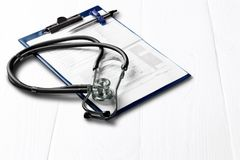 Medical doctor`s stethoscope on  background. Table medical stethoscope white background copy paper Royalty Free Stock Photos