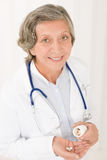 Medical doctor senior female hold pills smiling stock photos