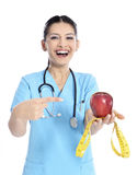 Medical doctor showing apple Royalty Free Stock Image