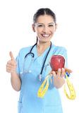Medical doctor showing apple Stock Images