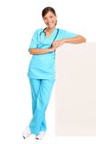 Medical doctor showing blank sign. Medical blank sign billboard. Young woman doctor / nurse showing empty sign. Female medical professional standing in full body royalty free stock images