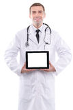 Medical doctor showing digital tablet pc with blank screen. Stock Photos