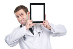 Medical doctor showing digital tablet pc with blank screen. Royalty Free Stock Photos