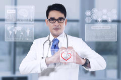 Medical doctor showing heart shape Royalty Free Stock Image