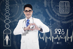Medical doctor showing heart sign Stock Image
