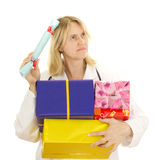 Medical doctor with some gifts. Medical doctor with some colourful gifts Stock Photos