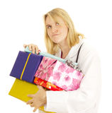Medical doctor with some gifts. Medical doctor with some colourful gifts Royalty Free Stock Photos