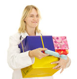 Medical doctor with some gifts. Medical doctor with some colourful gifts Stock Photo