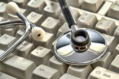 Medical Doctor Stethoscope on Computer Keyboard Royalty Free Stock Photos
