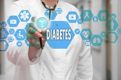 Medical Doctor with stethoscope and Diabetes icon in Medical net Stock Photography