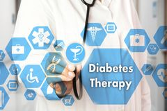 Medical Doctor with stethoscope and Diabetes Therapy icon in Med stock image