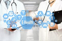 Medical Doctor with stethoscope and E-Health word in Medical net stock photography