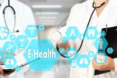 Medical Doctor with stethoscope and E-Health word in Medical net royalty free stock photos