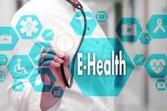 Medical Doctor with stethoscope and E-Health word in Medical net. Work connection on the virtual screen on hospital background.Technology and medicine concept stock images