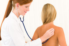 Medical doctor stethoscope examine woman patient Stock Photo