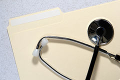 Medical Doctor Stethoscope on File Folder Stock Images