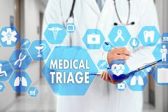 Medical Doctor with stethoscope and MEDICAL TRIAGE sign in Medic. Al network connection on the virtual screen on hospital background.Technology and medicine royalty free stock image